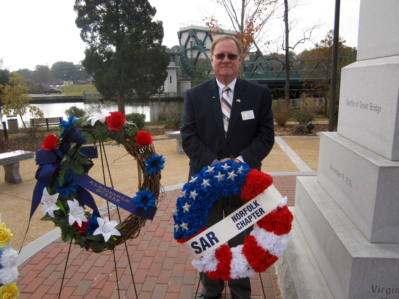 Norfolk Chapter SAR Secretary Edward Douglas presents the chapter wreath at the ceremony