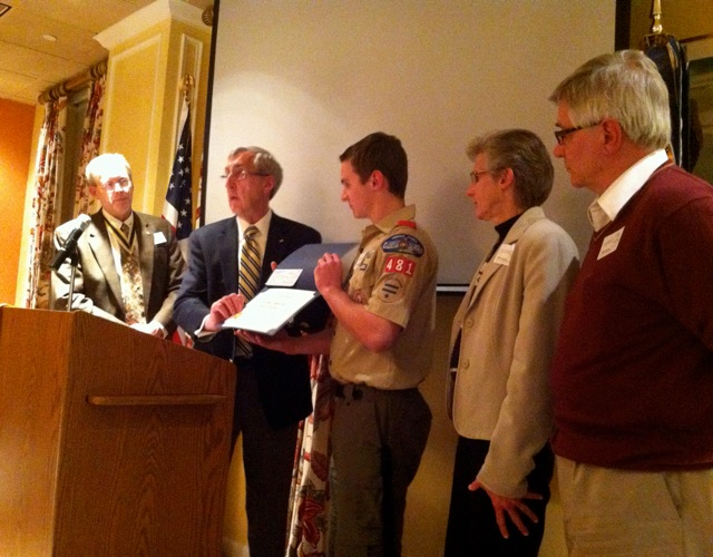 Eagle Scout Award presented to Marc Krudop by Treasurer and Eagle Scout Committee head Ken Hawkins along  with Compatriot and Past Norfolk SAR President Ken Hogendobler. Marc's parents look on.