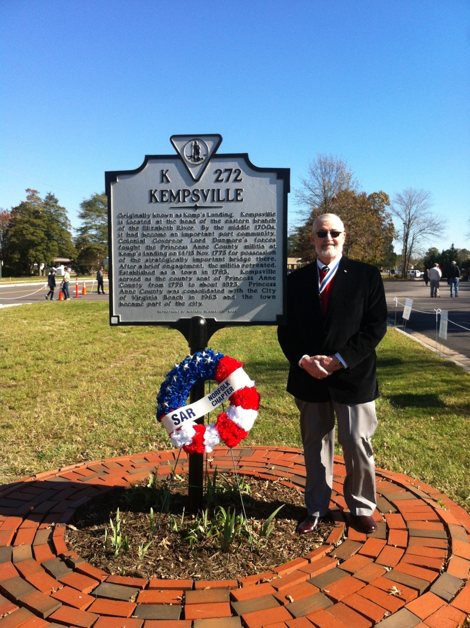 Norfolk Chapter SAR President Maury Weeks at the Kempsville Virginia State Marker with the chapter wreath