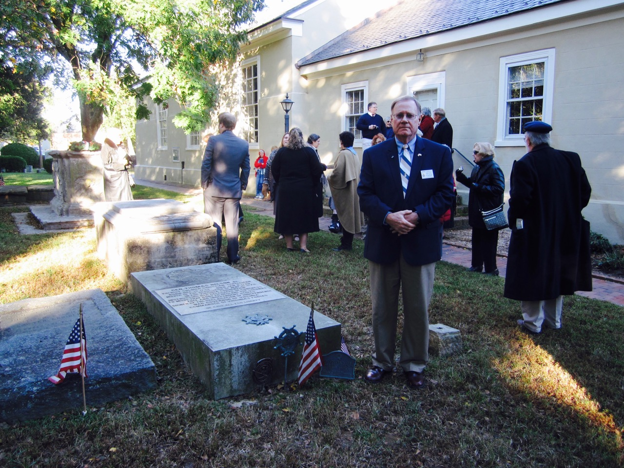 Norfolk Chapter Secretary Edward J. Douglas, III at the grave of General Thomas Nelson, Jr