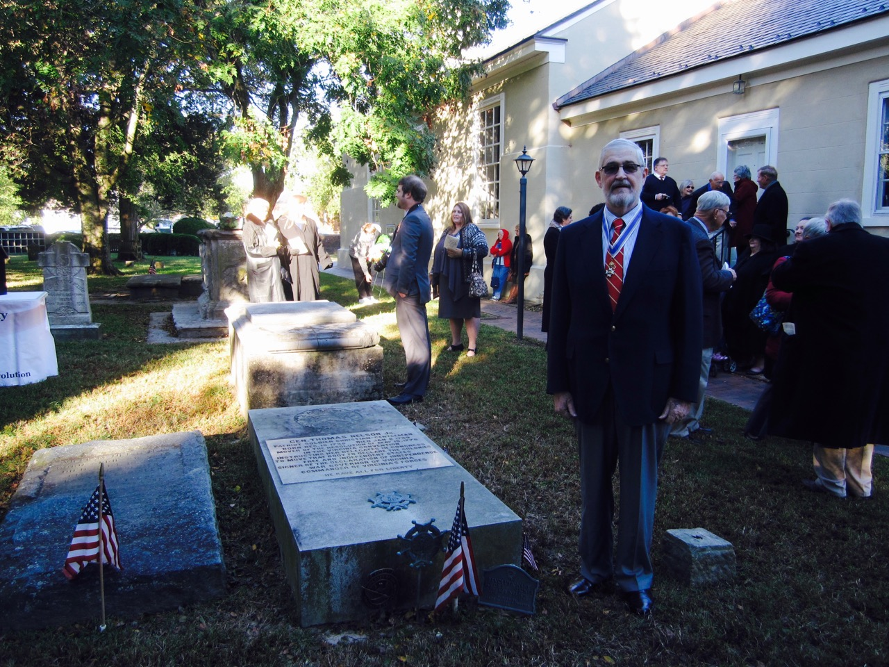Norfolk Chapter SAR President Maury Weeks at the grave of General Thomas Nelson, Jr