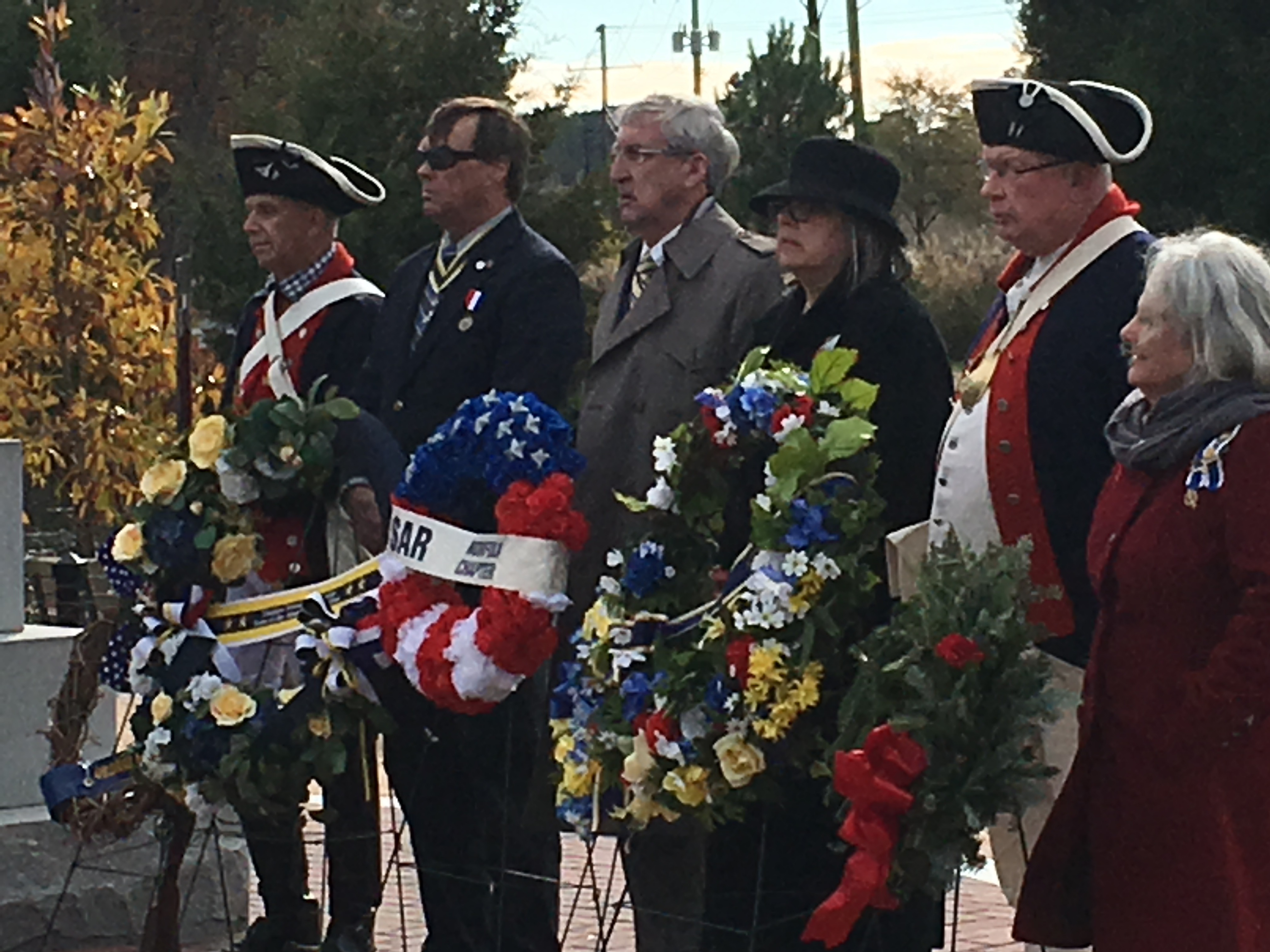 Treasurer and President Elect Kenneth Hawkins presents the Norfolk Chapter SAR wreath at the Battle of Great Bridge Monument
