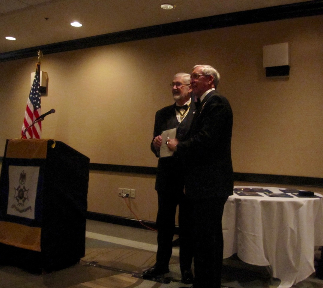President Maury Weeks presents Treasurer Ken Hawkins with the Virginia Society Chapter Award
