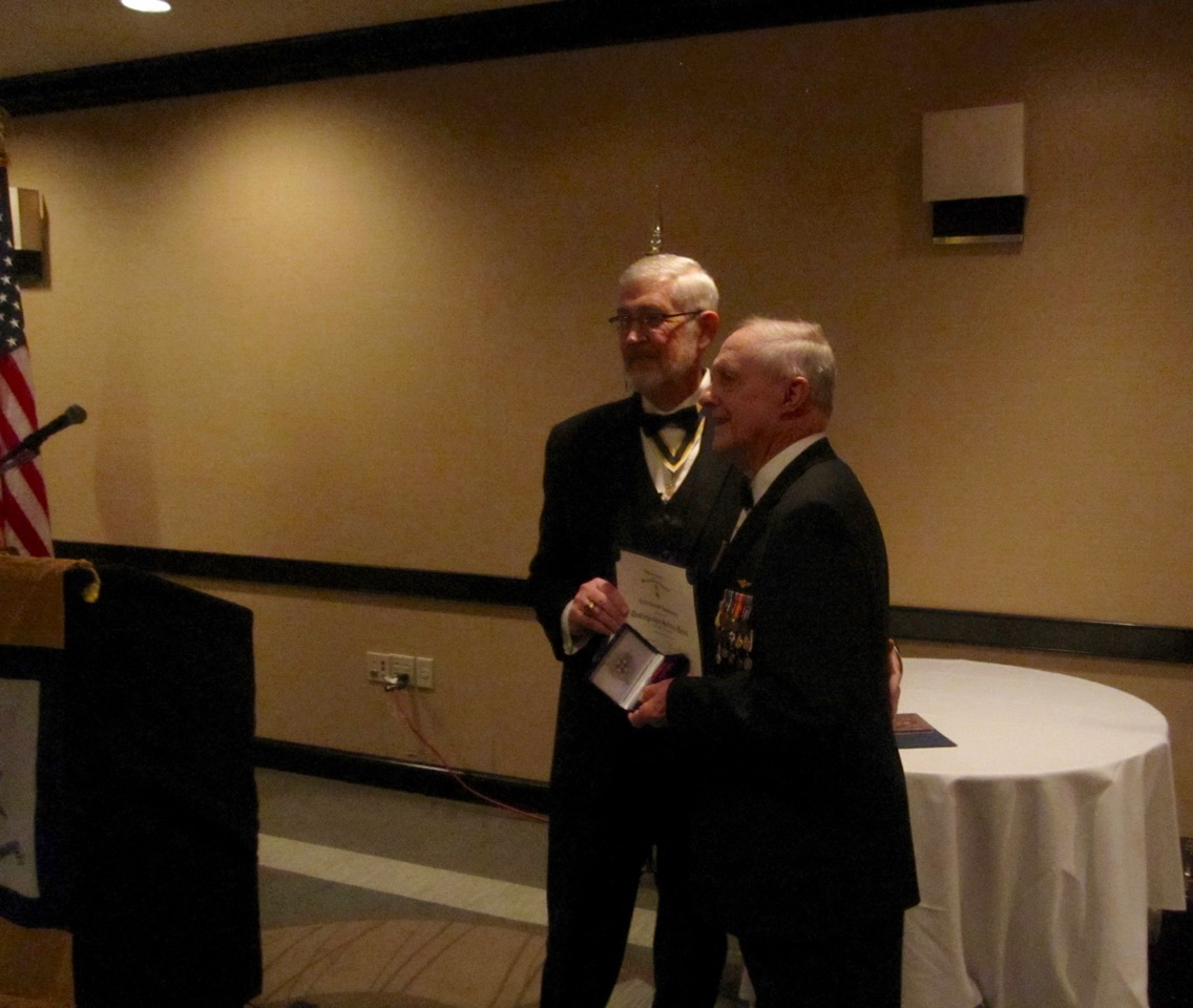 President Maury Weeks presents Compatriot Ken Hogendobler with the SAR Distinguished Service award in recognition of his many years of dedicated service as Chairman of ROTC.