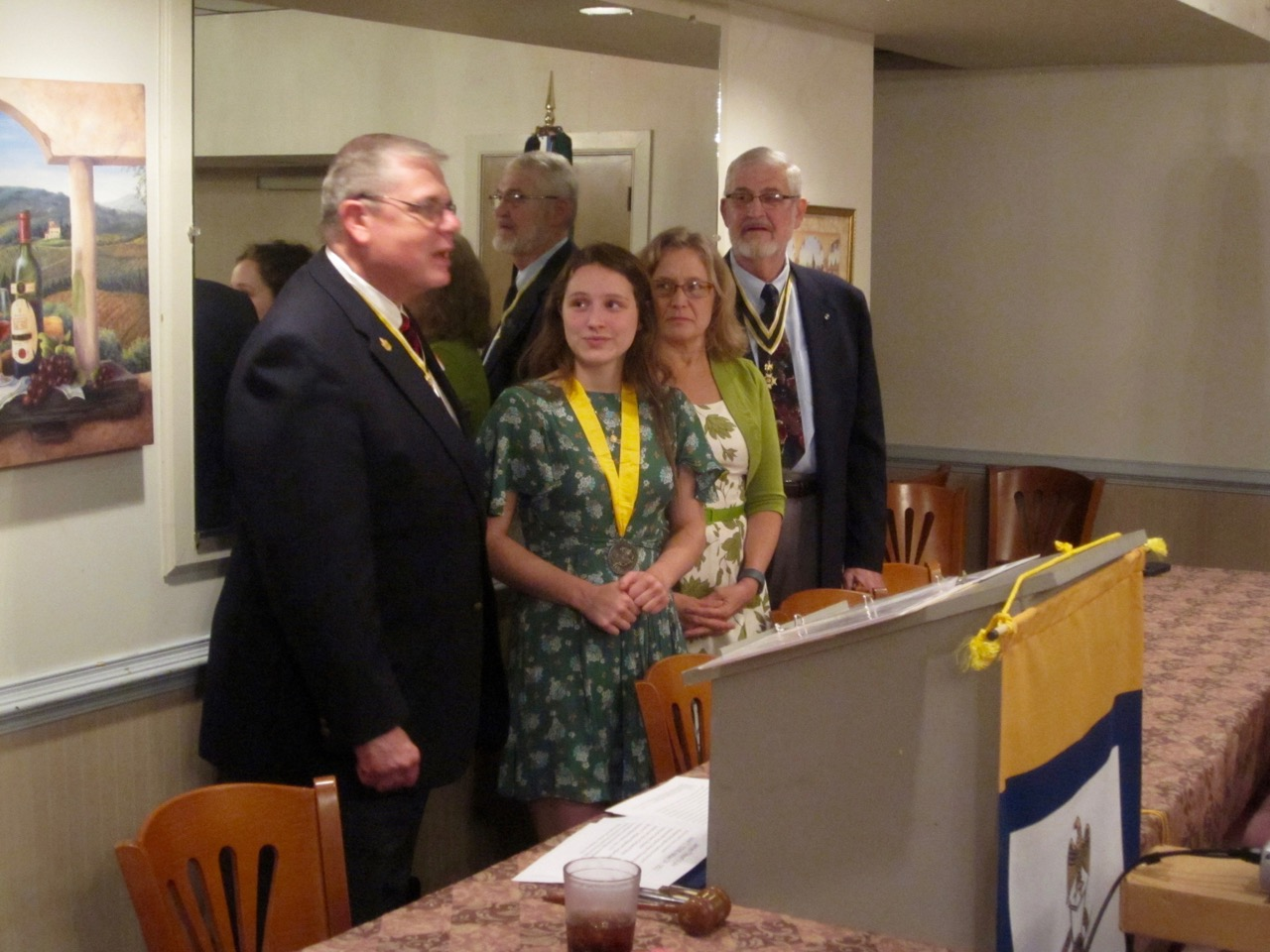 Past President Tom Whetstone and President Maury Weeks present Hannah Wheaton with her Knight Essay Certificate along with a check for $100.00 as her mother, Laurie Wheaton, looks on