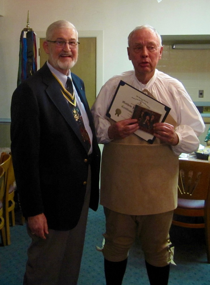 "President Maury Weeks presents our guest speaker, Col. John Barlow, with a Certificate of Appreciation along with a CD entitled ""Jefferson's Fiddle\""."