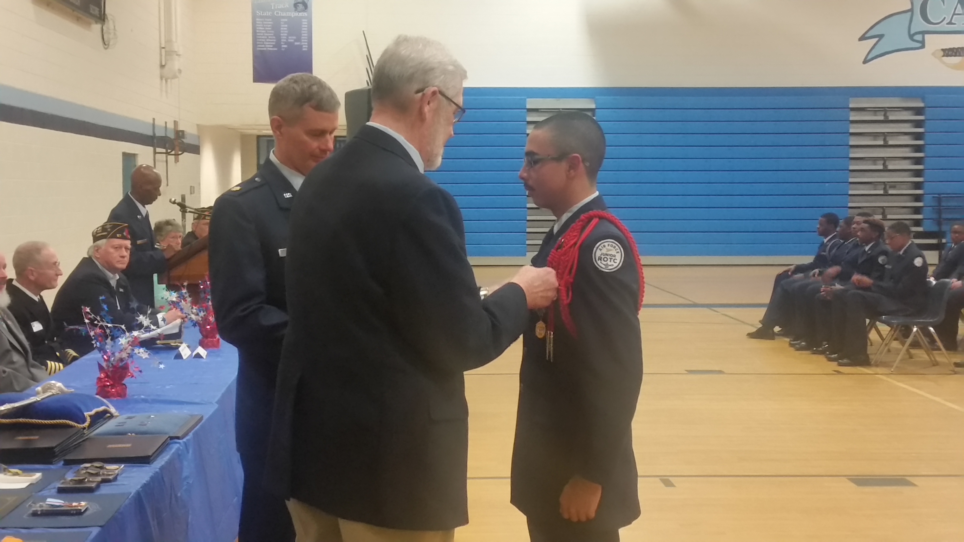 President Maury Weeks presents Nelson Rosa with the SAR Bronze ROTC Medal.
