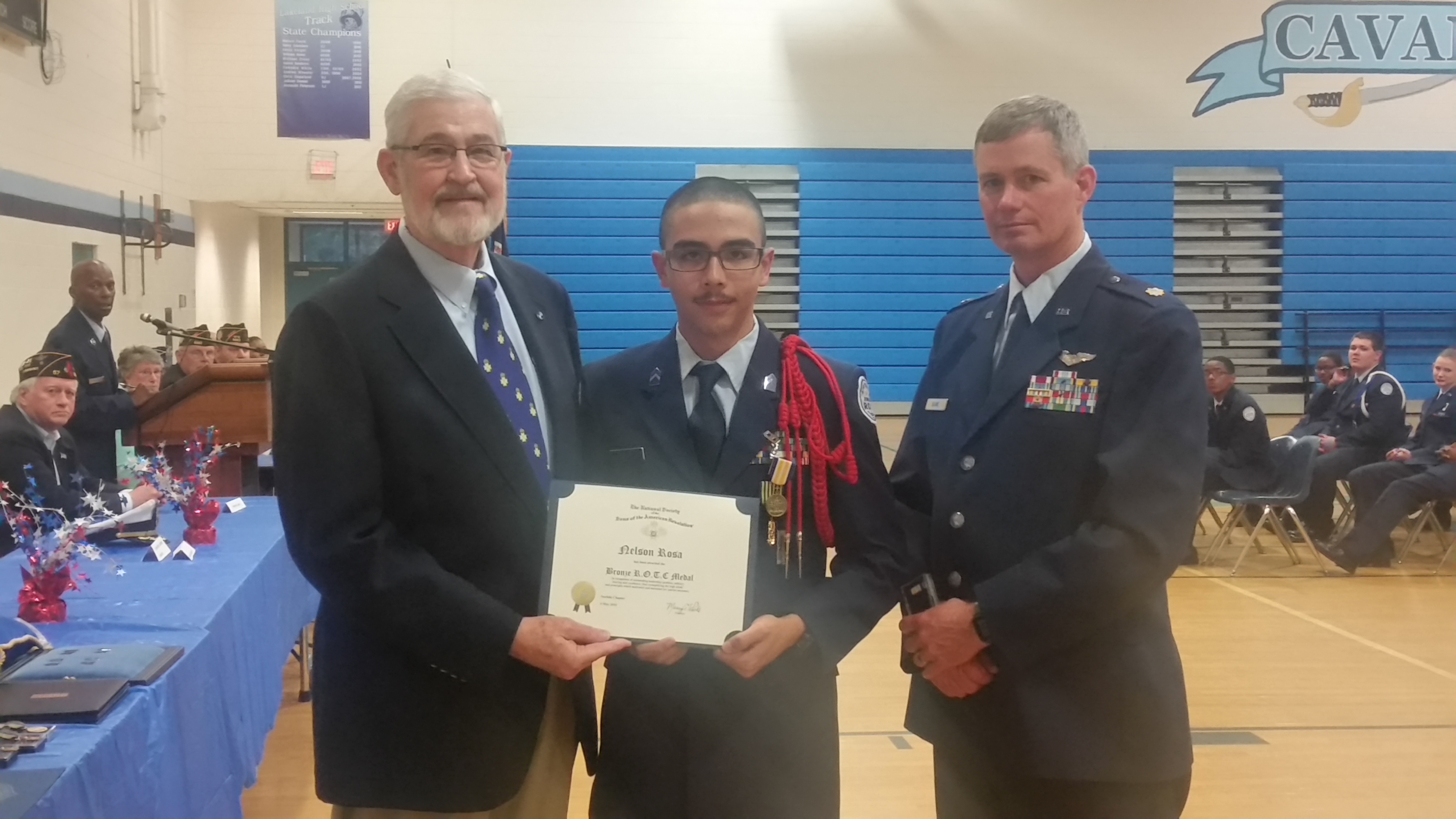 President Maury Weeks presents the SAR Bronze ROTC Certificate to Nelson Rosa.