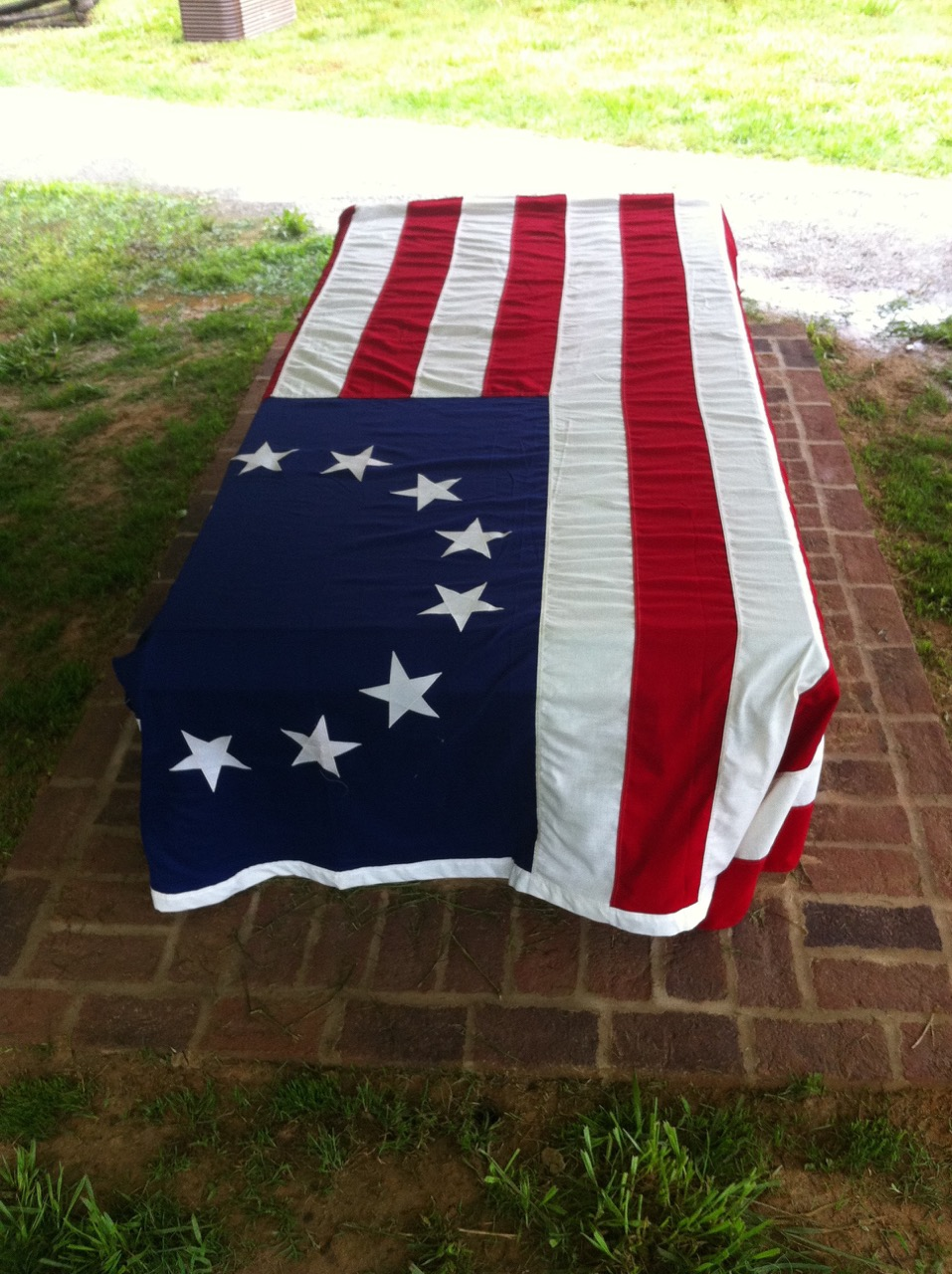 The flagged draped Tomb of the Unknown Patriot Soldier of the American Revolution