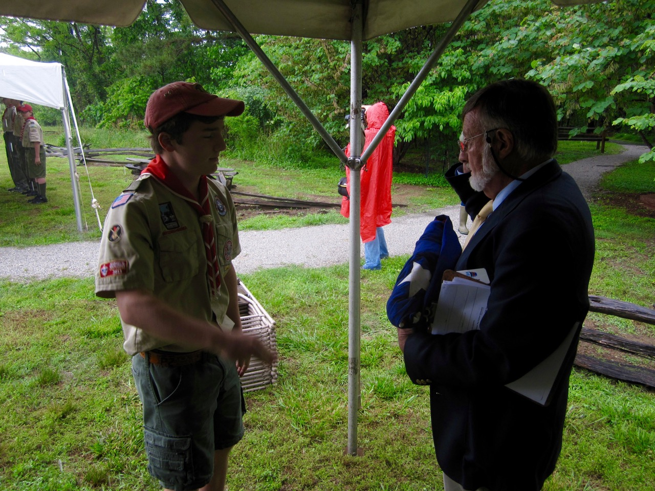 A member of Boy Scout Troop 103 of Williamsburg presents the flag to Mr. Alain C. Outlaw, Archaeologist