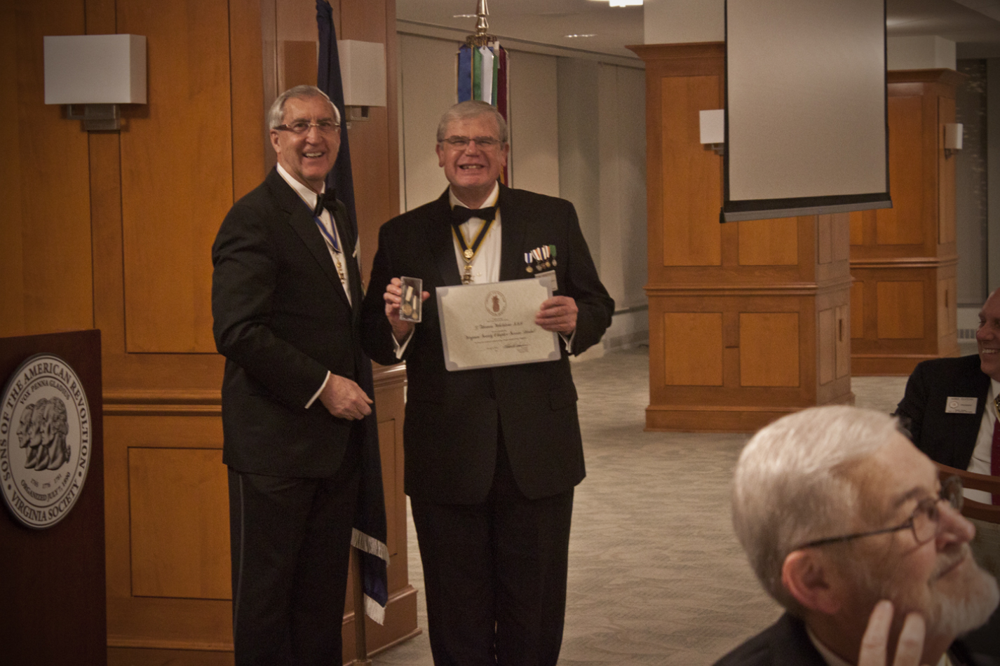 President Hawkins presents Past President Tom Whetstone with the Virginia Society Service Medal and Certificate