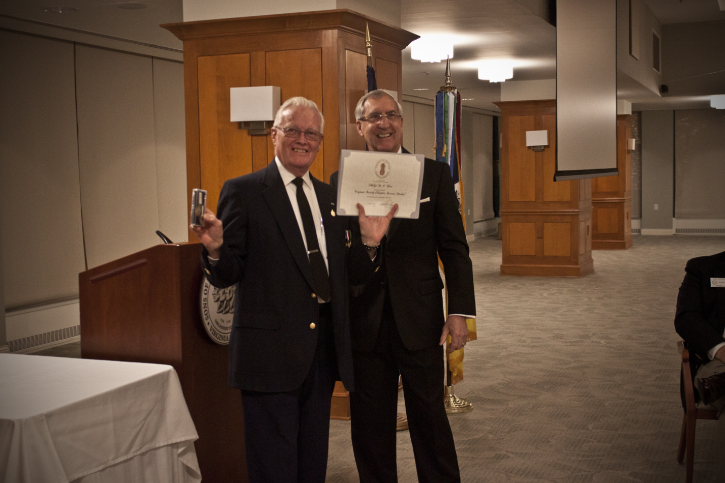 President Hawkins presents Treasurer Mike O'Shea with the Virginia Society Service Medal and Certificate