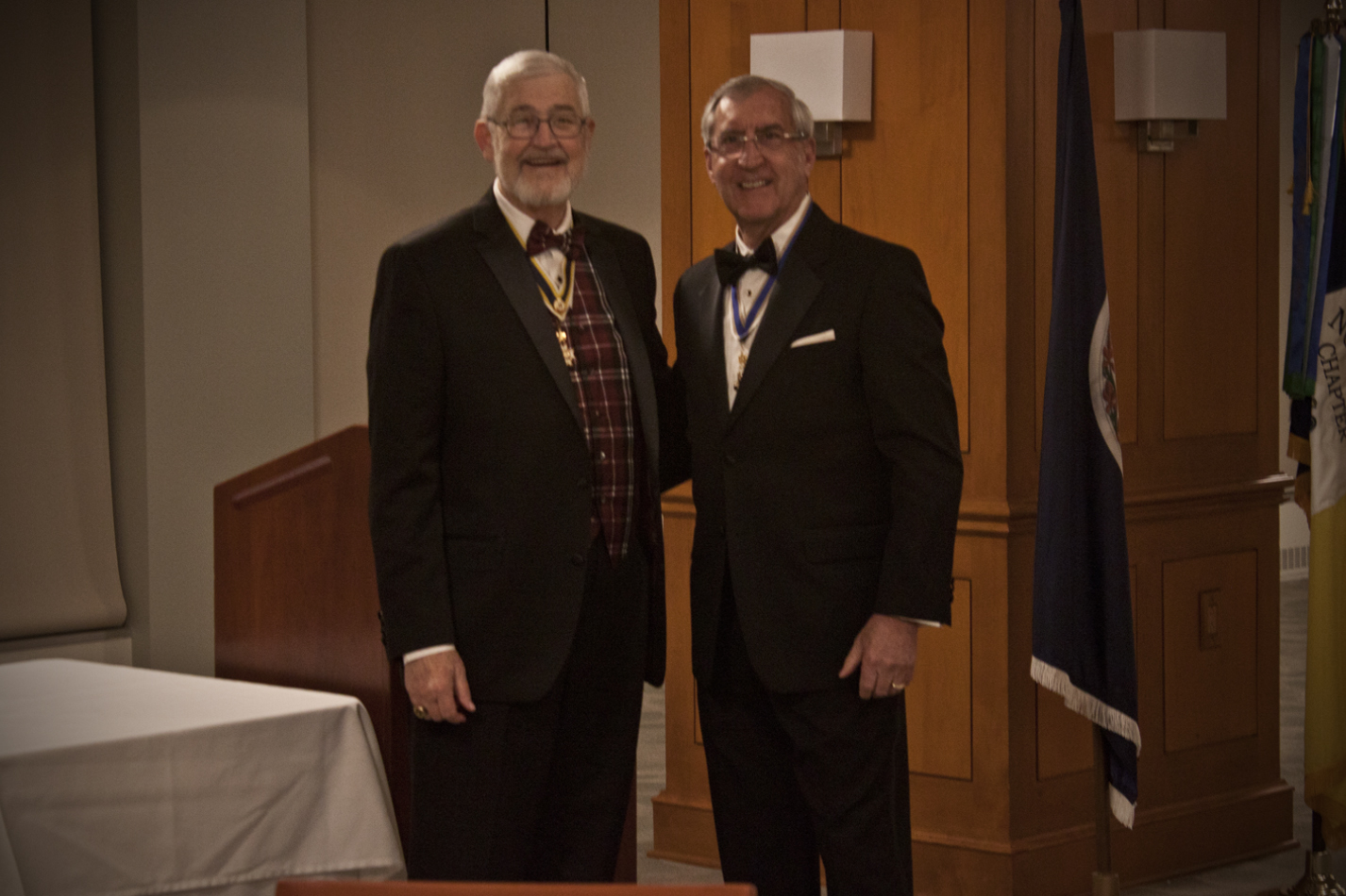 President Hawkins presents Immediate Past President Maury Weeks with the Meritorious Service Medal and Certificate