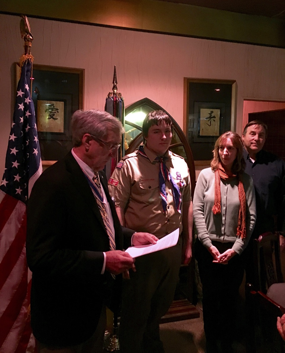 Noah Bieker received the Eagle Scout Award from President Ken Hawkins as his parents, Daniel and Catherine Bieker look on.