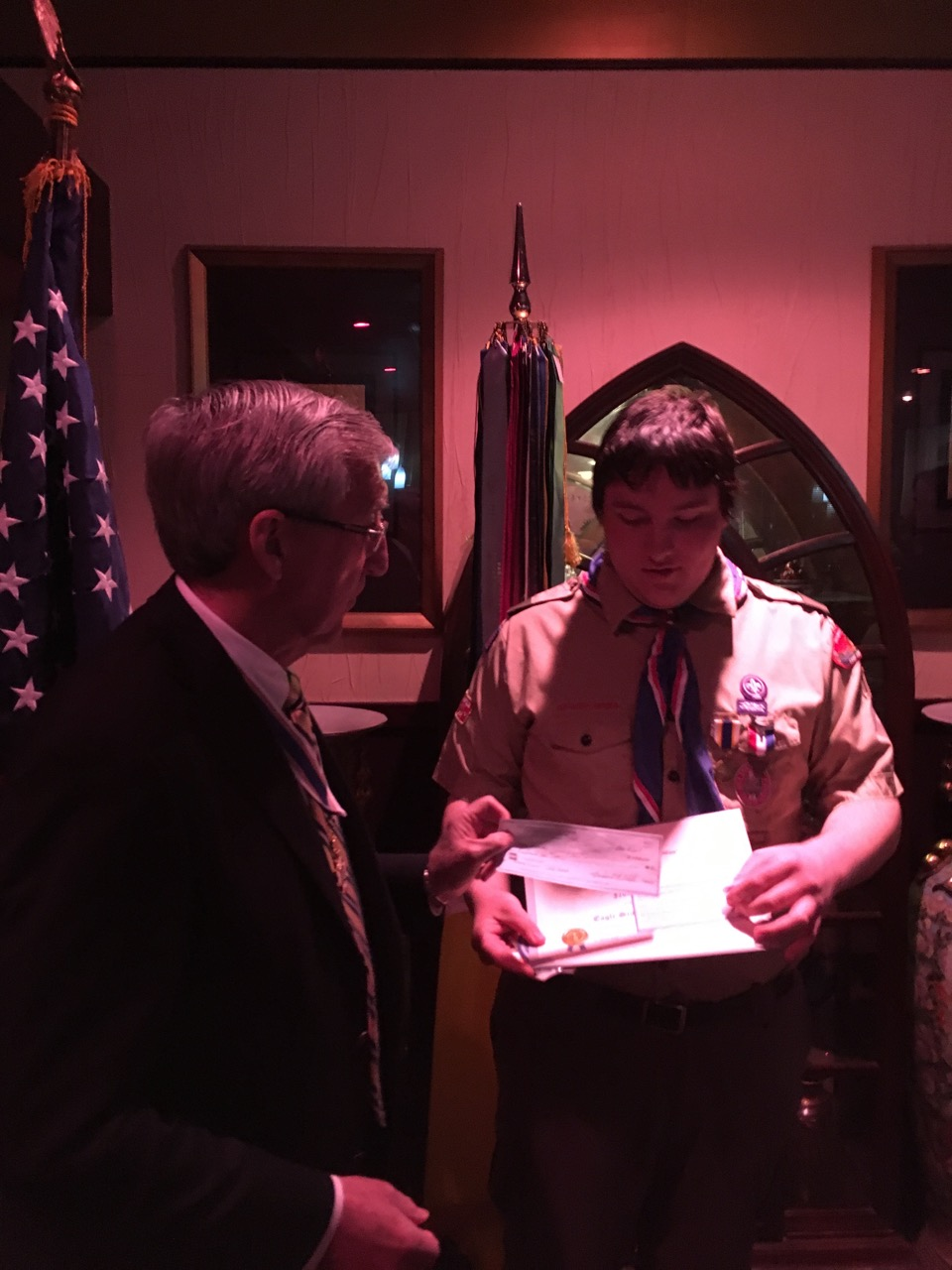 Eagle Scout Award recipient, Noah Bieker, receives his award check, medal and certificate from President Ken Hawkins