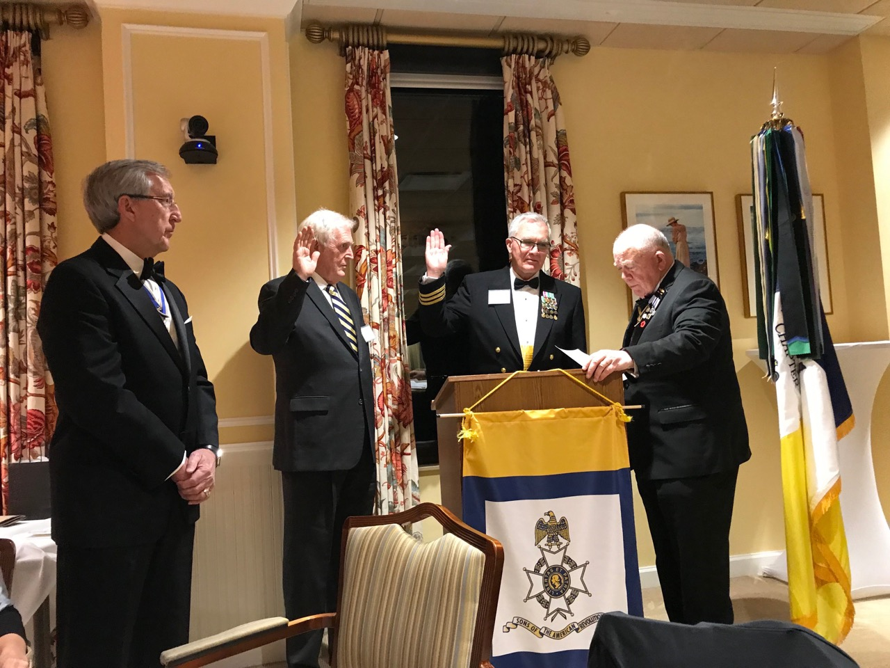 New members Lindsey Jones and Mark Jumper are sworn into the chapter by VASSAR President Patrick Kelly. President Ken Hawkins looks on.