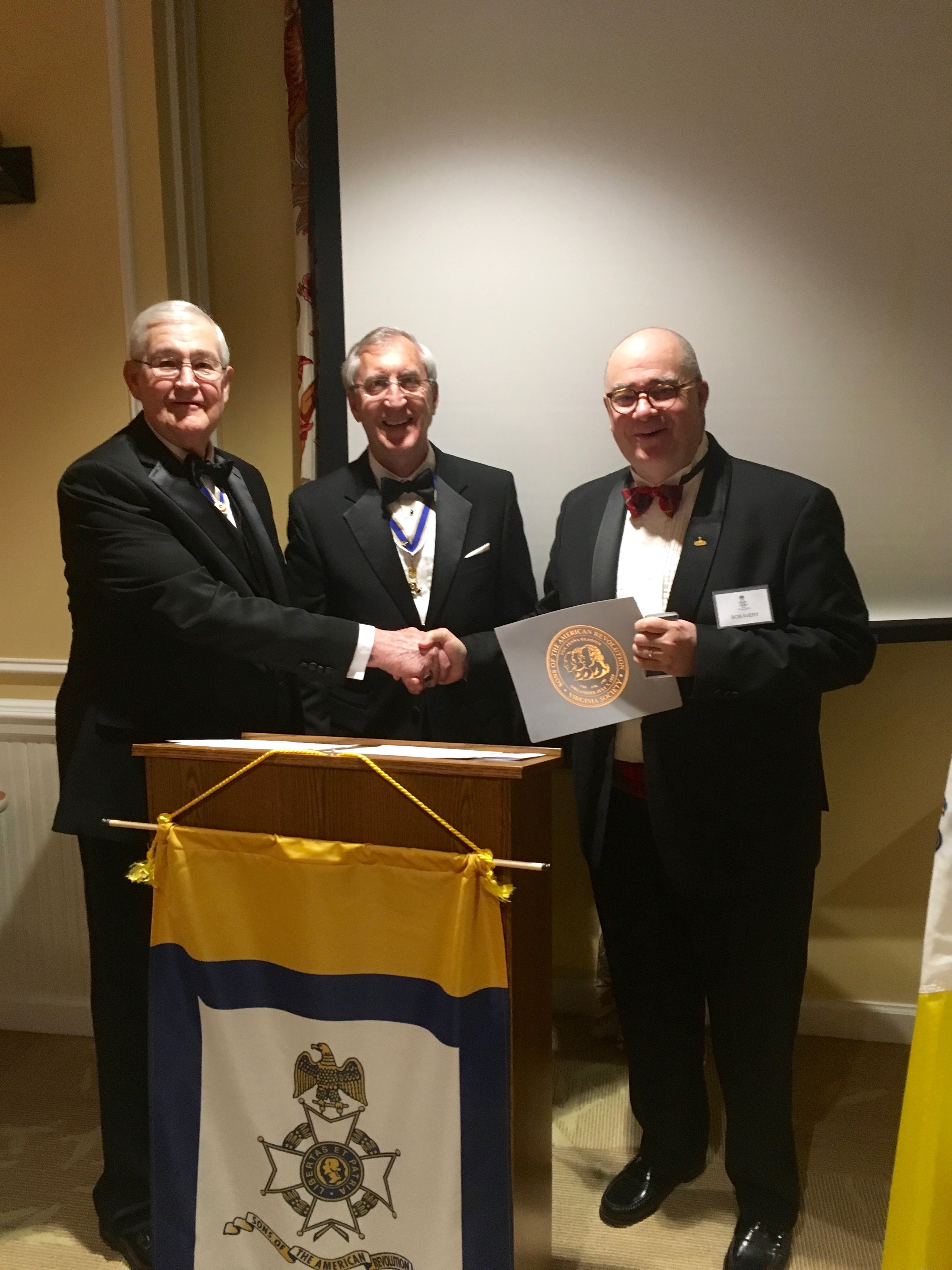 Outgoing Chapter Registrar Bob Avery is awarded the Distinguished Service Medal and Certificate by President Ken Hawkins and Past President Maury Weeks.