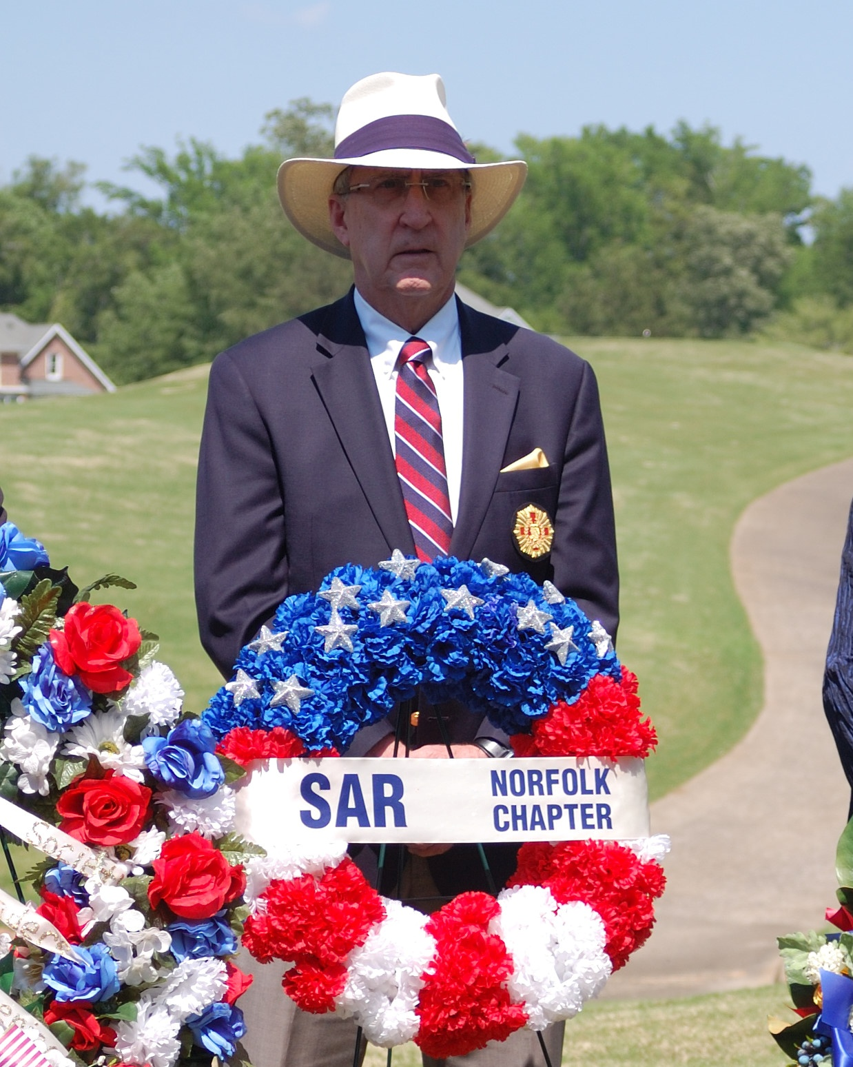 Norfolk Chapter SAR President, who is also a member of the Order of Founders and Patriots of America, presents the Norfolk Chapter SAR wreath at the re-interment ceremony