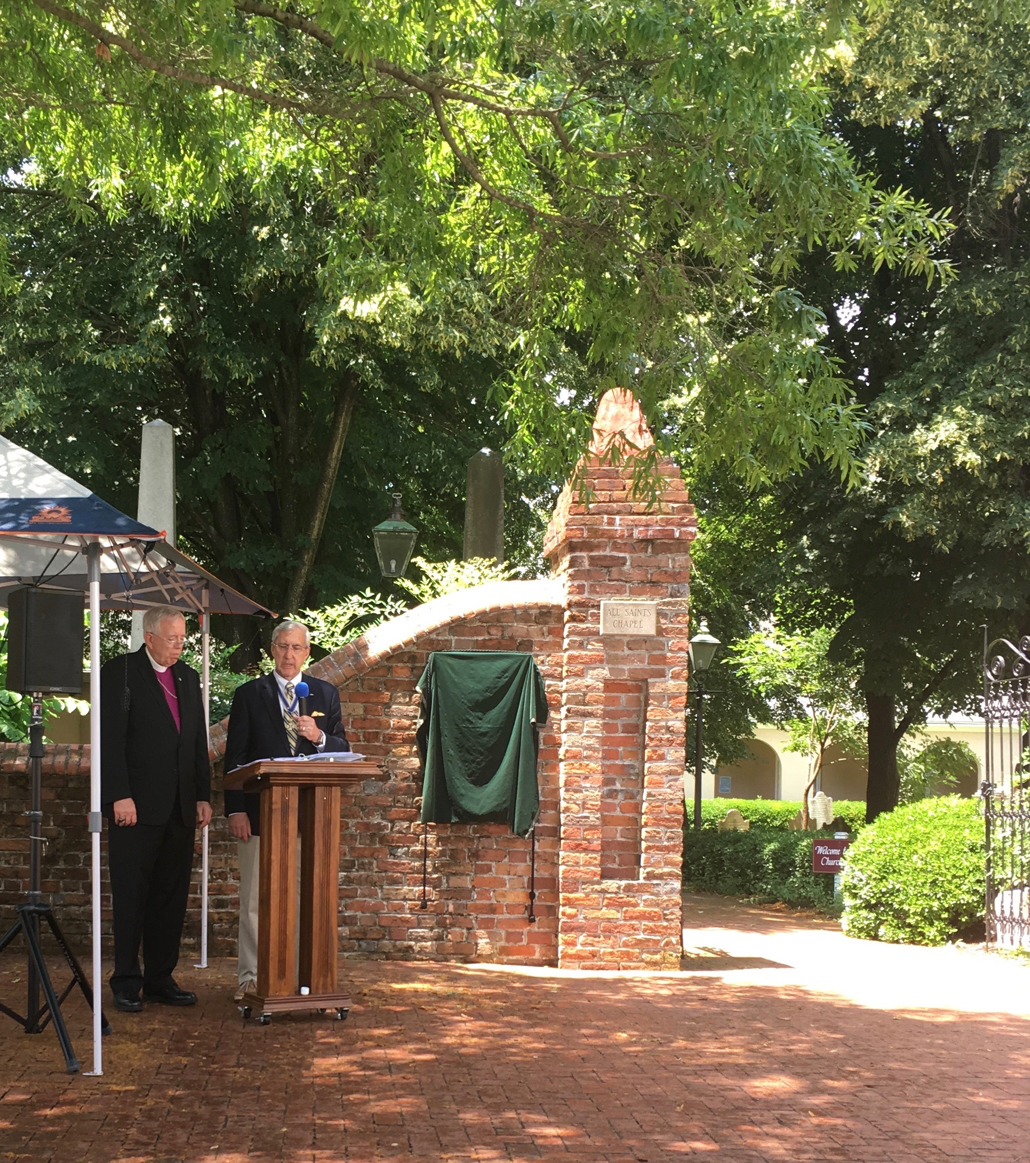 President Kenneth Hawkins and Bishop James Magness address the crowd just before the unveiling of the plaque.