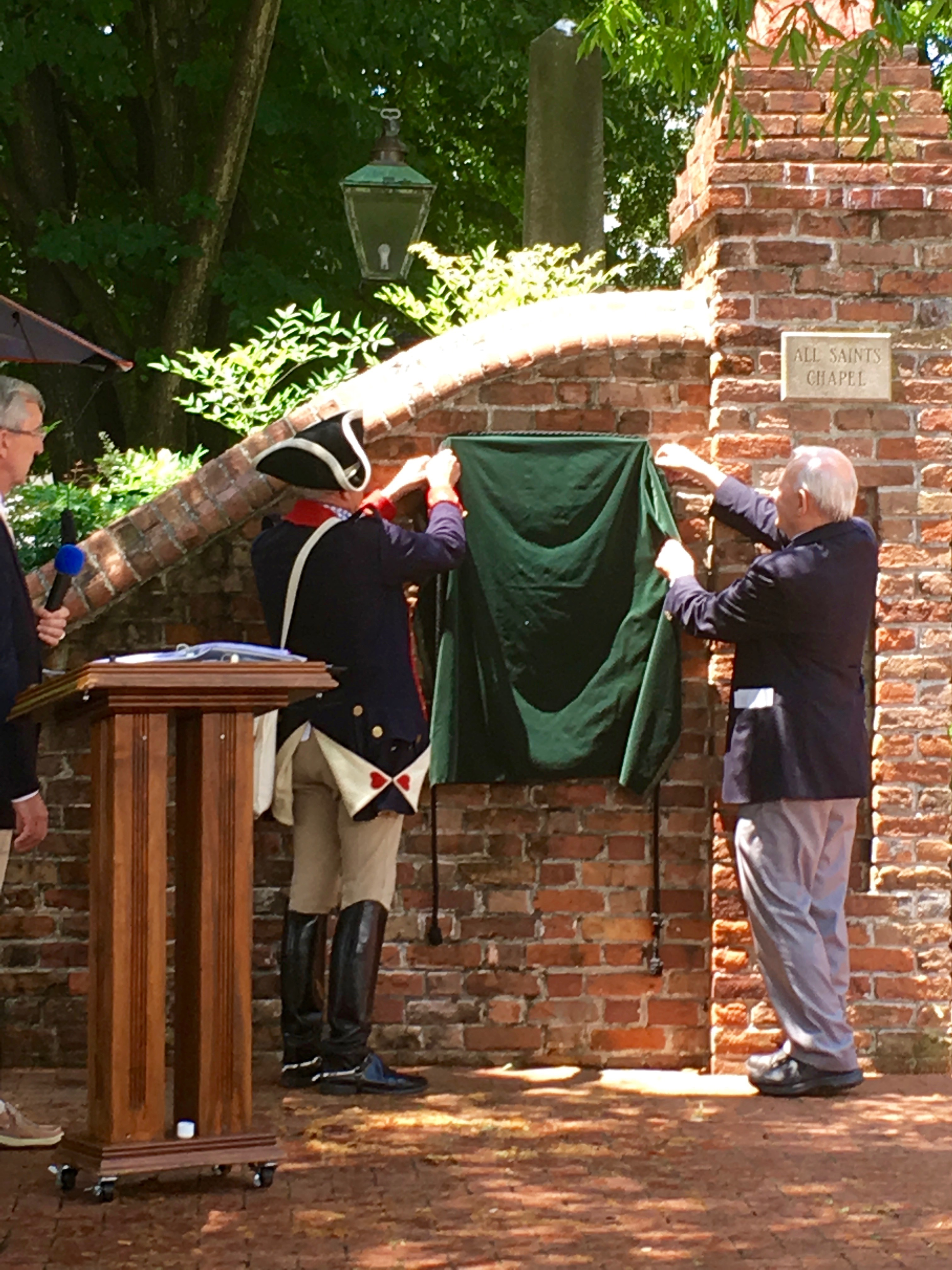 The plaque honoring the Revolutionary War and War of 1812 Patriots is unveiled