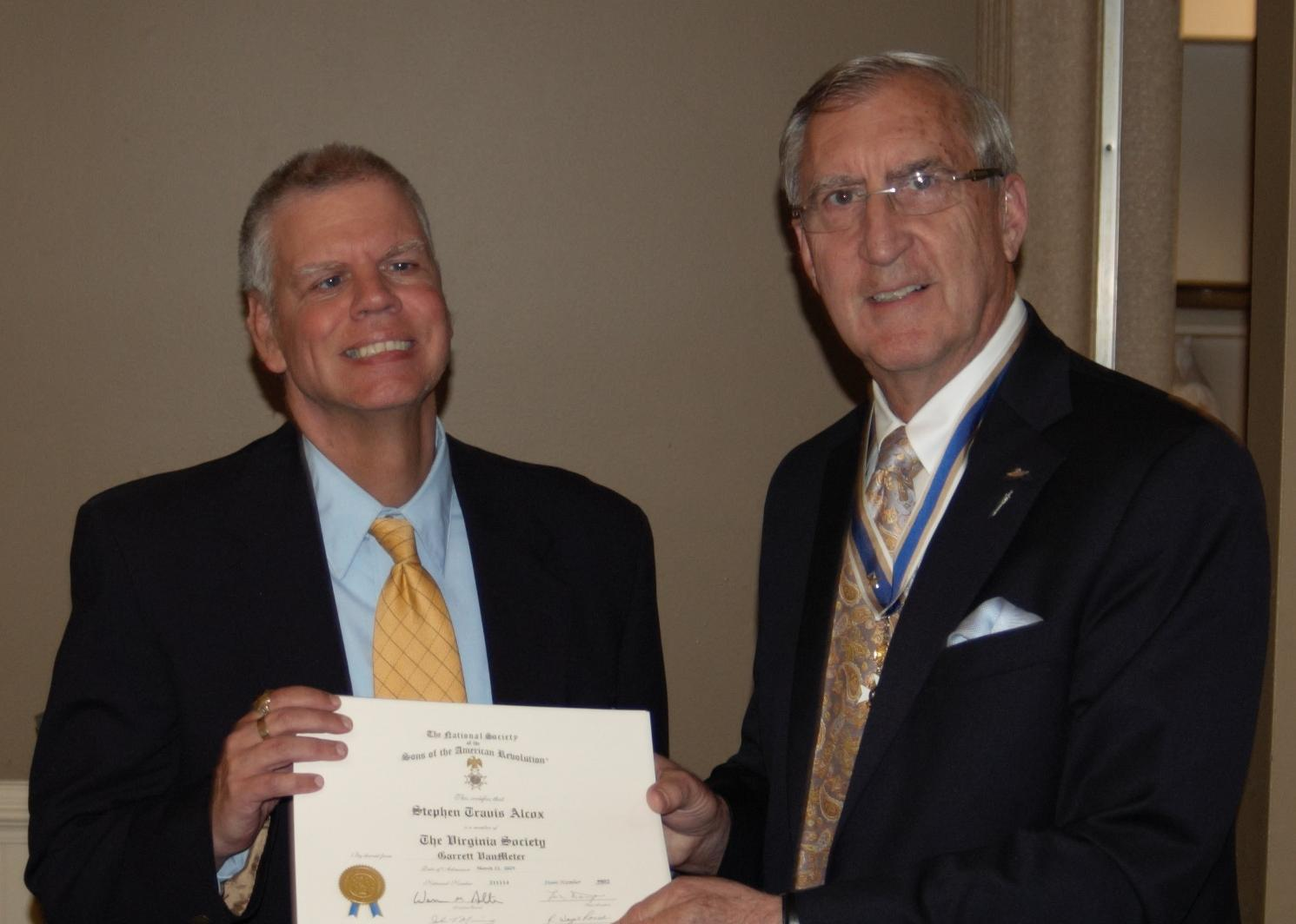 Newly inducted member Stephen Alcox receives his SAR Certificate from President Hawkins.