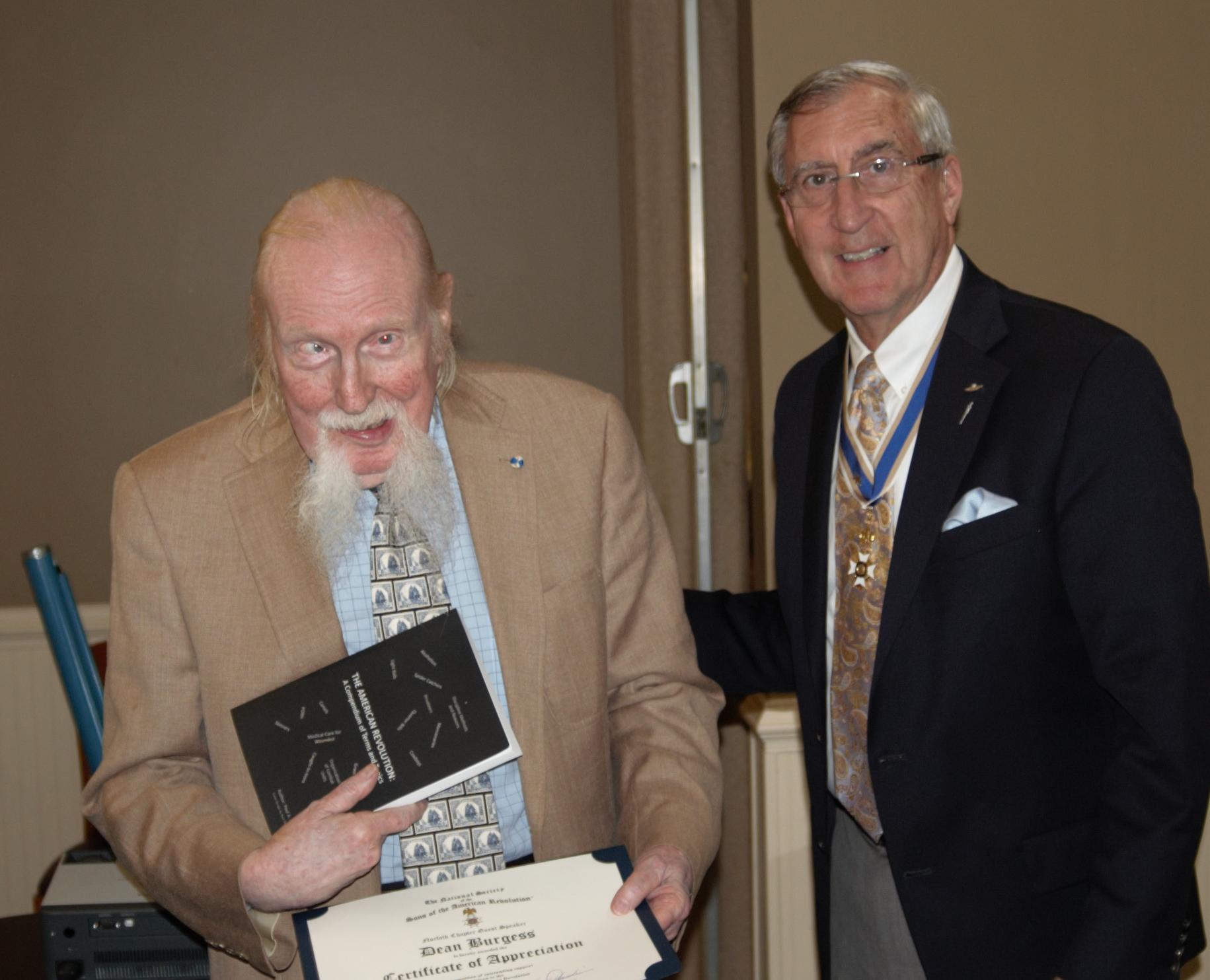 Compatriot and Guest Speaker Dean Burgess receives a book and Certificate of Appreciation from President Hawkins