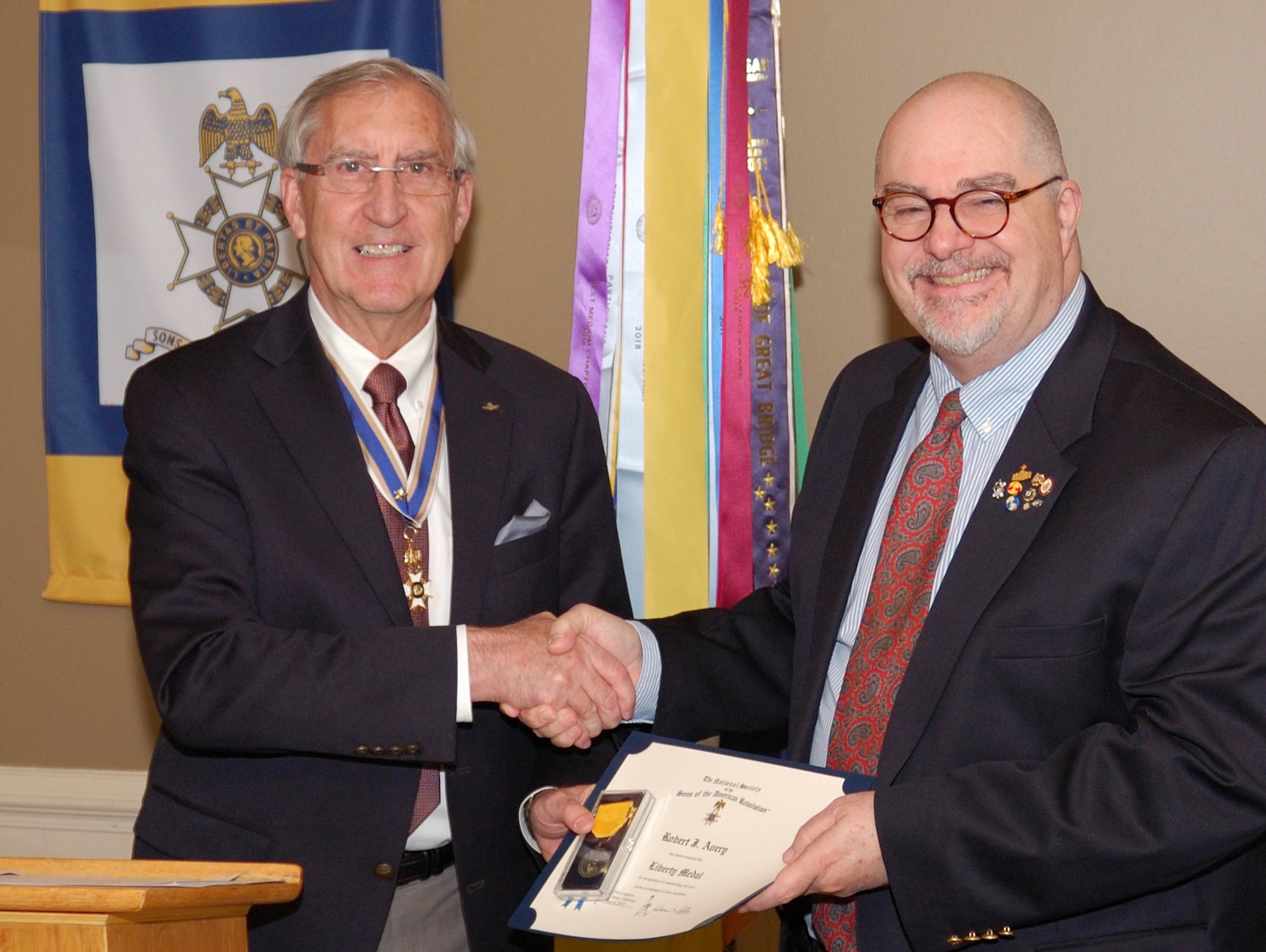 Compatriot Bob Avery receives the Liberty Medal from President Ken Hawkins