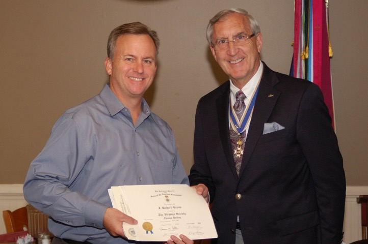 President Hawkins presents the SAR Membership Certificate to newly inducted member Richard Braun